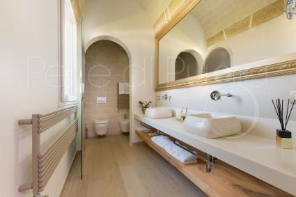 The elegant bathroom of Suite Ionia has double sink